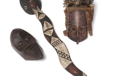 Three masks of carved patinated wood, one with woven raffia, other with red, white and black pigment. D. R. Congo and Bobo style. H. 27–110 cm. (3)