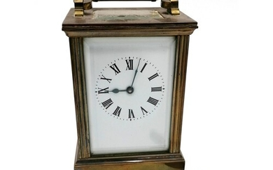 brass carriage clock with a porcelain face. Running, with ke...