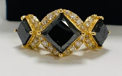 14ct Yellow Gold black Diamond trilogy ring featuring...