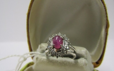 18CT WHITE GOLD DIAMOND & RUBY CLUSTER RING, principle caboc...