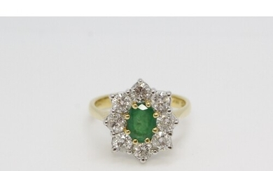 18ct yellow gold oval emerald and diamond cluster ring. Emer...