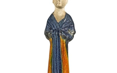 A BLUE AND AMBER-GLAZED POTTERY FIGURE OF A COURT LADY TANG DYNASTY | 唐 三彩仕女陶俑