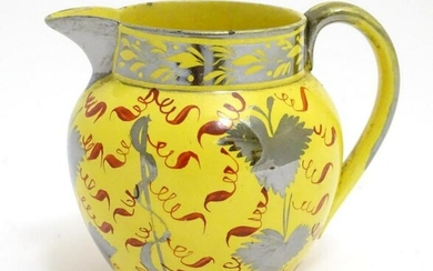 A 19thC canary yellow Sunderland lustre cream jug with