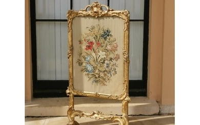 A CARVED CHIPPENDALE PERIOD GILTWOOD FIRE SCREEN Retaining o...