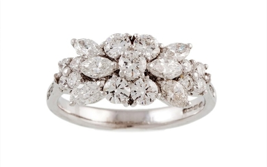 A DIAMOND CLUSTER RING, with oval and brilliant cut diamonds...