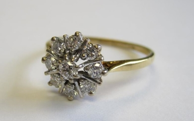 A Diamond Cluster Ring claw-set nine brilliant-cut stones in...
