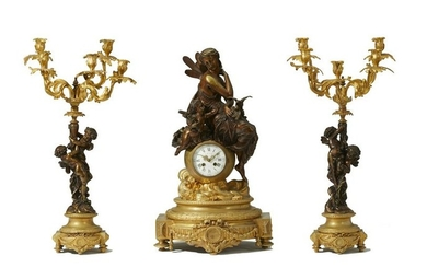 A French gilt and patinated bronze clock and garniture