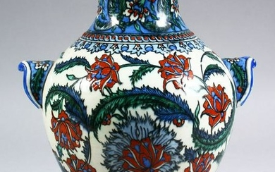 A GOOD EARLY IZNIC POTTERY VASE decorated with flora