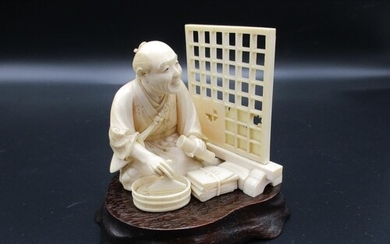 A Japanese Meiji period ivory okimono, modelled as a man pos...