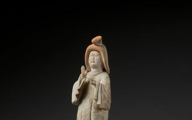 A LARGE PAINTED RED POTTERY FIGURE OF A...
