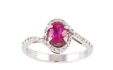 A RUBY AND DIAMOND CLUSTER RING, the oval ruby to cross over...