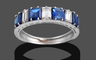 A Sapphire and Diamond Seven Stone Ring, four step cut...