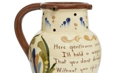 A Torquay motto puzzle jug, inscribed with...