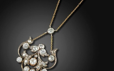 A Victorian natural pearl and diamond pendant, of scrolling foliate design set overall with graduated old circular-cut diamonds in silver and gold, suspending an articulated pearl, 5cm high, chain 38cm long Accompanied by report number 18491 dated 10...
