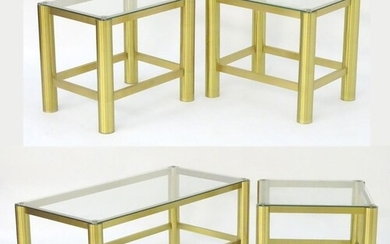 A collection of brass and glass coffee tables, comprising a ...