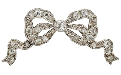 A diamond bow brooch, the openwork ribbon...