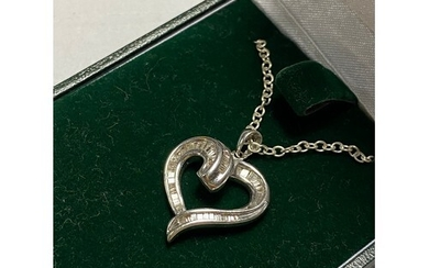 A diamond set heart shaped pendant, in white gold and on ass...