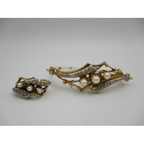 A gold coloured metal bracelet set with three pearls, flanke...