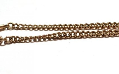 A graduated curb link watch chain, each link stamped '9'...