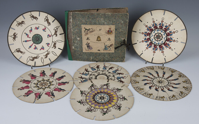 A group of 19th century Fantascope discs, comprising a set of six hand-coloured discs and their orig