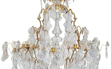 A large chandelier with gilt bronze mounts and...