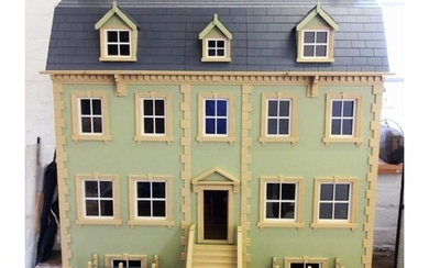 A late 20th century hand made custom built dolls house, circ...