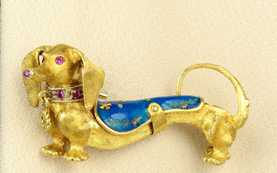 A mid 20th century gold dachshund dog brooch, with ruby and enamel highlights.