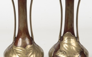 A pair of Japanese Meiji period bronze overlay twin handled ...