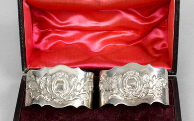 A pair of Victorian silver napkin rings, in fitted case.