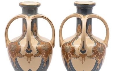 A pair of Villeroy Boch pottery vases: of footed oviform wit...