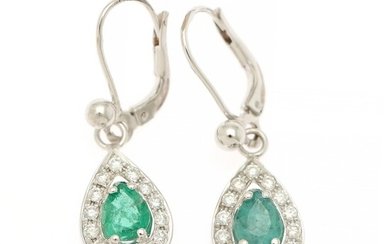 A pair of emerald and diamond ear pendants each set with a pear shaped emerald encircled by numerous brilliant-cut diamonds, mounted in 14k white gold. (2)