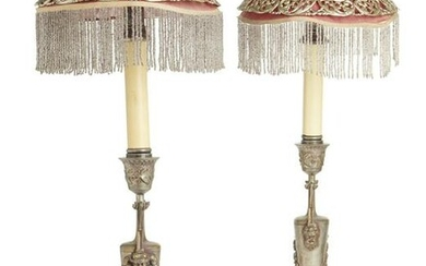 A pair of spelter candlesticks with shades