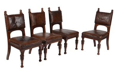 A set of four Renaissance Revival walnut and leather upholstered side chairs