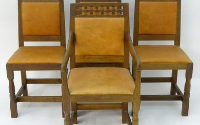 A set of four oak Arts and Crafts style dining chairs