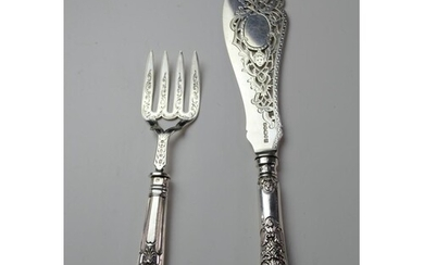 A silver fish knife and fork server. Fish knife is hallmarke...