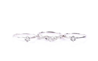A suite of three diamond rings, comprising two single stone ...