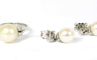 A white gold cultured pearl and diamond ring