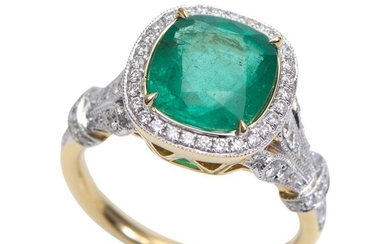 AN EMERALD AND DIAMOND RING-Featuring a cushion cut emerald weighing 3.09cts, with diamonds set to the surround and shoulders totall...
