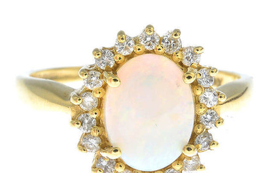 An 18ct gold opal and diamond cluster ring.