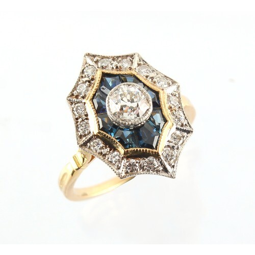 An 18ct yellow gold sapphire & diamond cluster ring with con...