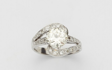 An 18k white gold diamond solitaire ring