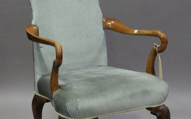An early 20th century Queen Anne style walnut framed shepherd's crook elbow chair, raised on ca