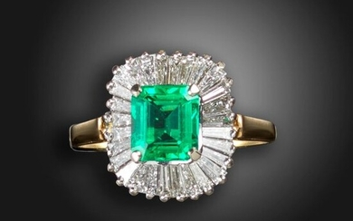 An emerald and diamond ballerina ring, the emerald-cut emerald weighs approximately 1.90cts, set within a surround of tapered baguette-shaped diamonds in white and yellow gold, size P Accompanied by report number 81278-57 dated 29 September 2020 from...