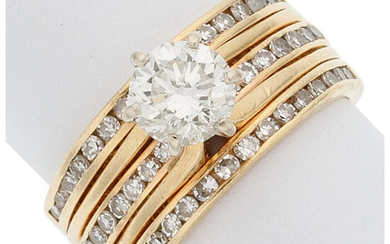 Diamond, Gold Ring The ring centers a round brilliant-cut...