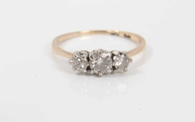 Diamond three stone ring with three round brilliant cut diamonds in claw setting on 18ct yellow gold shank. Estimated total diamond weight approximately 0.50cts, ring size L.