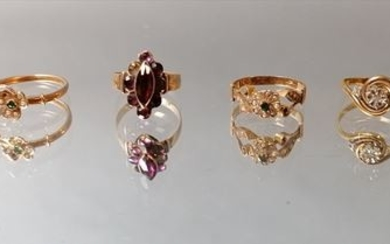 Gold ring sets including a marquise ring decorated...