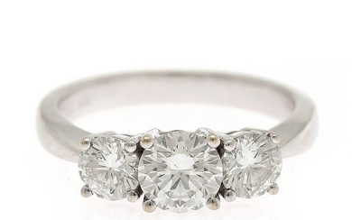Hartmann's: A diamond ring set with a brilliant-cut diamond weighing app. 0.80 ct. flanked by brilliant-cut diamonds, mounted in 18k white gold. F/VS1-SI1.