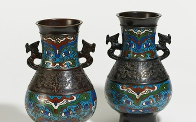 Pair of bronze vases with taotie masks and dragons