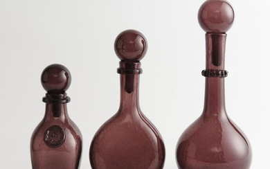 THREE FRENCH BIOT HAND BLOWN VIOLET BOTTLES WITH STOPPERS, ALL ETCHED 'BIOT' TO BASE, THE TALLEST 30.5 CM HIGH, LEONARD JOEL LOCAL D...
