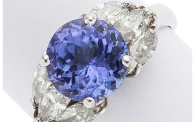 Tanzanite, Diamond, White Gold Ring The ring centers a...